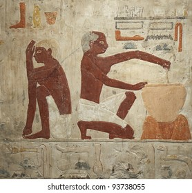 A wall painting of an ancient egyptian making batter for bread manufacturing. 5th Dynasty (2500-2350 BC)