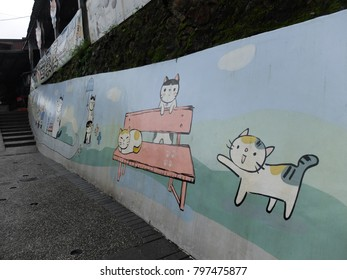 Wall painting in Taiwan's Houtong cat village, the village with more than 200 cats live in.