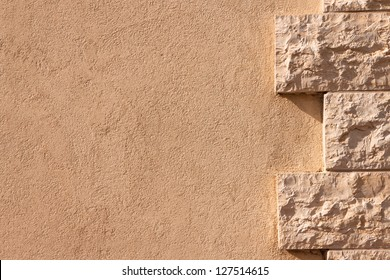 Wall partially lined with natural stone