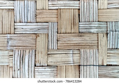 Wall of plaited bamboo strips, bamboo weave, partition made of woven bamboo strips, background, wallpaper