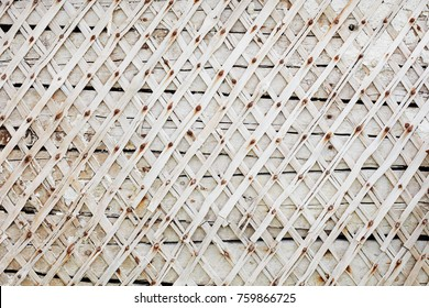 Wall with planks nailed. Rhombuses pattern. Background white wall