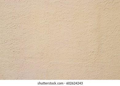 Wall plaster. Beige plastered background in natural light. Horizontal.
