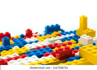 Wall from Plastic building blocks isolated on white background. Top view with copy space