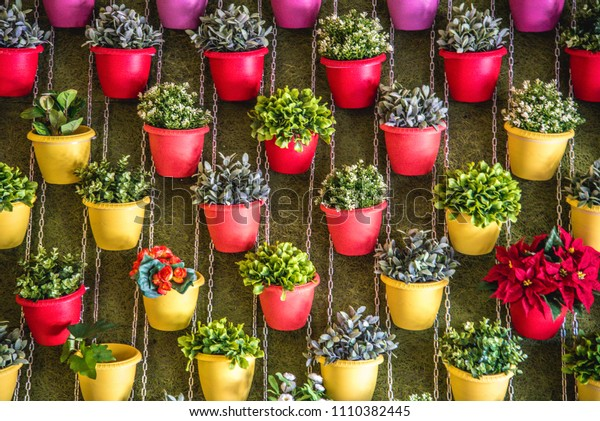 Wall of pots with flowers