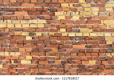 Wall with red and yellow bricks