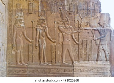 The wall relief of Cleopatra III, Cleopatra II and Ptolemy VIII in front of eagle-headed god Horus, Kom Ombo, Egypt.