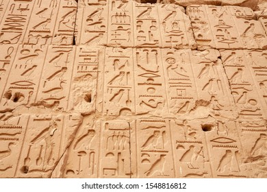 Wall Relief with Hieroglyphs at Precinct of Amun Re. Karnak Temple Complex, Luxor, Egypt