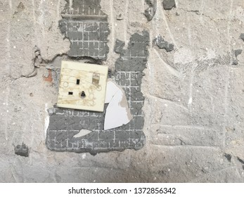 Wall renovation works. Mosaics have been removed. There is an old power socket that has a burning effect.