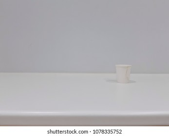Wall room with white table and coffee cup, available space
