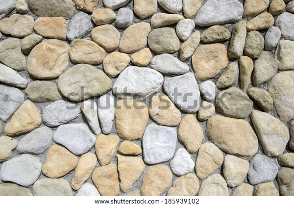Wall round stone rock texture background