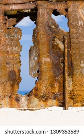Wall of rust, closeup of a ship wreck at sandy beach, Zakynthos, Greece.