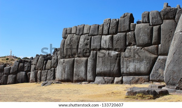 Wall of Sacsayhuaman and statue of Christ in far background