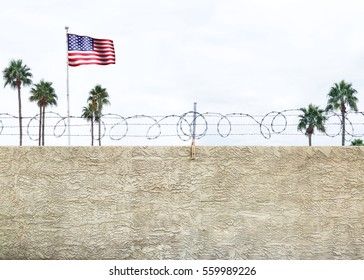 Wall with secure barbed wire fence along the southern border of the United States