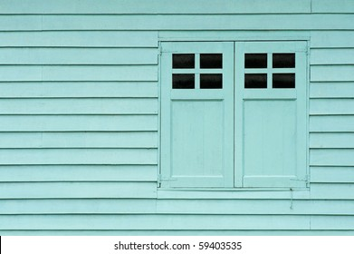 a wall of a shed with doors