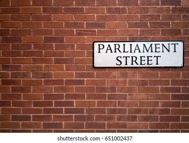 Wall with a sign of Parliament Street. It is believed that this is the narrowest street in the world. Exeter. Devon. England