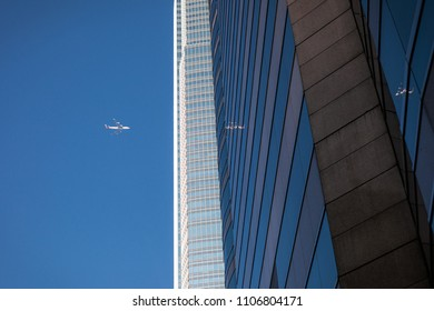 Wall of skyscraper business office with a airplane silhouette