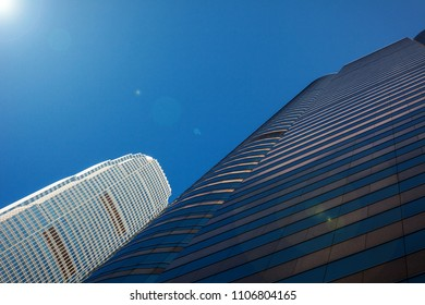 Wall of skyscraper business office with blue sky, corporate building in city
