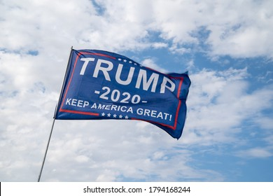 Wall, South Dakota - July 24, 2020: A Donald Trump 2020 Keep America Great flag blows in the wind, for the republican party