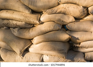 Wall of stacked sandbags for flood control.