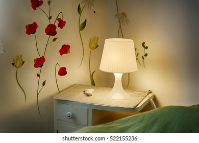 wall stickers, bedside table and lamp