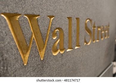 Wall Street engraved gold in granite, shot under an angle, high depth of field effect