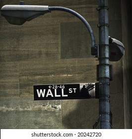 Wall street financial sign on lamp post