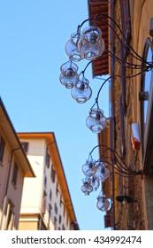 Wall street lanterns. Florence, Tuscany, Italy