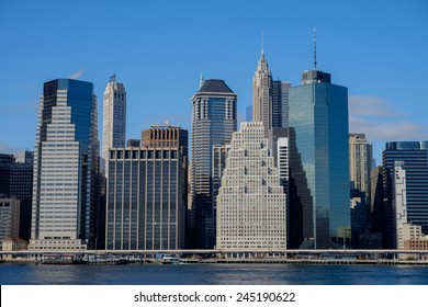 Wall Street and the lower Manhattan New York Financial District in late afternoon light