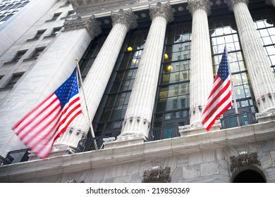 Wall street sign in New York, January 20, 2014 - New York Stock Exchange background