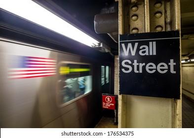 Wall street subway sign in New York City Manhattan station.