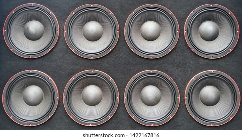 Wall of subwoofer bass speakers close up.