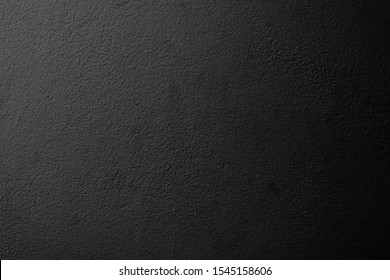 The wall surface is painted in black