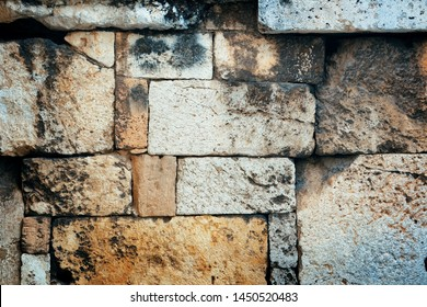 Wall texture in Acropolis historical ruins in Athens, Greece.