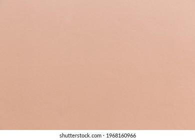 ฺBrown wall texture. Texture of the wall for background. Brown wall soft light background. The structure of an old brown cement surface. Flesh color
