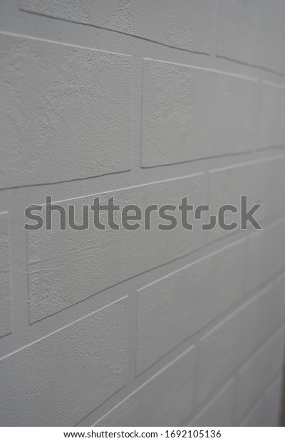 Wall texture consisting of white bricks made of decorative plaster