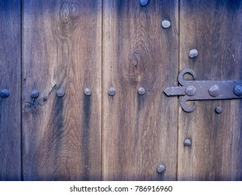 Wall texture with nails, old wood plank background, brown grunge surface, detail view