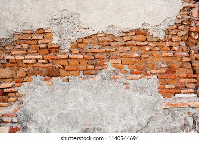 Wall texture of old red masonry brick. Outdoor exterior urban facade with destroyed uneven chipped brick pattern. Solid wall (dirty block) structure background. Grunge surface useful for 3d texturing