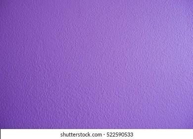 Wall texture purple background. Violet color lavender plain pastel wallpaper.