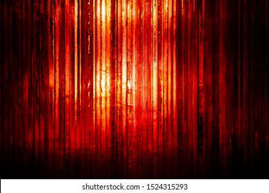 Wall of thick red glass in vertical stripes full frame backdrop
