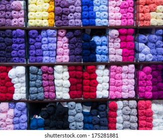 Wall of thread for knitting in a needlework shop.