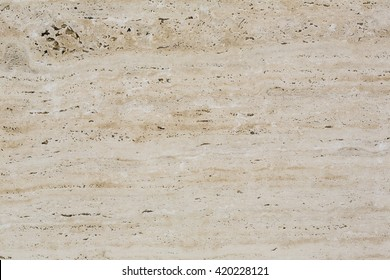 Wall of travertine with stone layers of different colors. Close up architecture macro photography. Creative wallpaper photography.