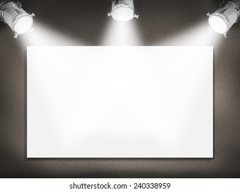Wall with white empty picture and spotlights