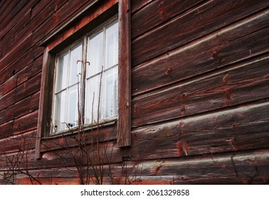 Wall and window of an old logcabin