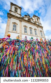 Wall of wish ribbons blowing in the wind at the famous Nosso Senhor do Bonfim da Bahia church in Salvador Bahia Brazil. Translation: Memory of Our Lord of Bonfim