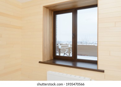 Wall with wooden modern window and wooden walls