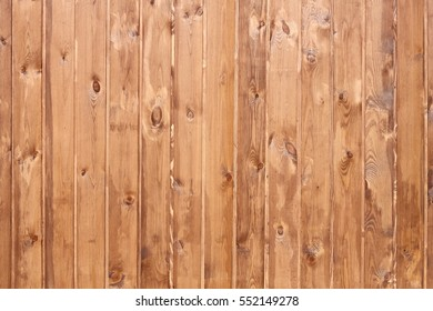 Wall of wooden planks vertical.