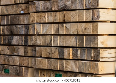 Wall of wooden square blocks. Tree bark texture