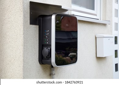 Wallbox on a house wall for simultaneous charging of two electric cars.