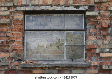 Walled-up window of a brick building