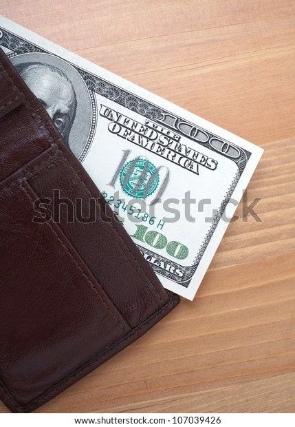 Wallet with 100 dollars